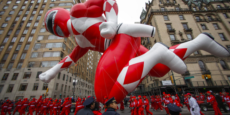 The red Mighty Morphin Power Ranger floats down Central Park West during the 88th Macy's Thanksgiving Day Parade in New York November 27, 2014. REUTERS/Eduardo Munoz (UNITED STATES - Tags: SOCIETY) - RTR4FV5E
